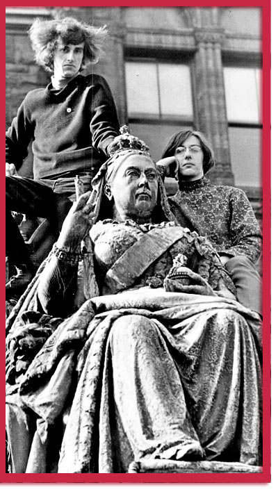 Paul Willis (left) and Michael VadeBoncoeur on a Queen Victoria Statue - photo by Dick Darrell, 1968