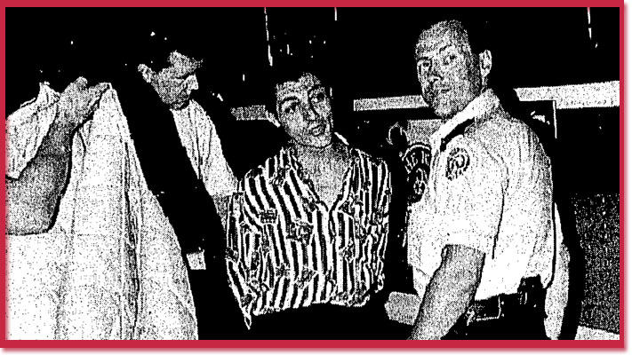 Arrest of Dougal MacDonald by police - photo by Tony Costas
