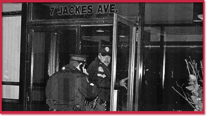 Photo of police entering the building where Henry Durost was murdered